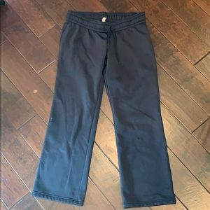 UA fleece-lined, flare-legged pants. Size L